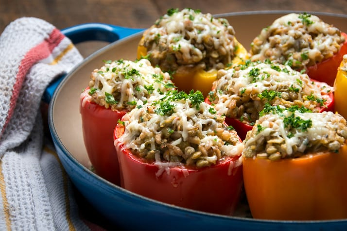 healthy lentil and farro stuffed peppers with asiago, cream cheese and yogurt