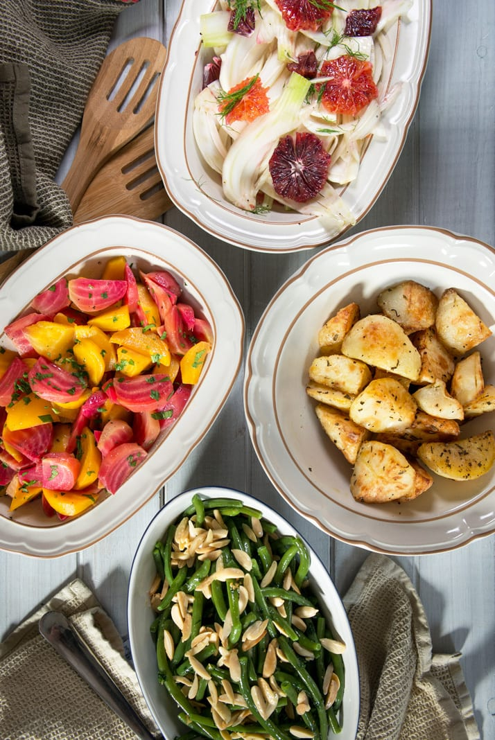 italian-easter-side-dishes, roasted potatoes, beet salad, fennel and blood orange, green beans with almond and evoo dressing