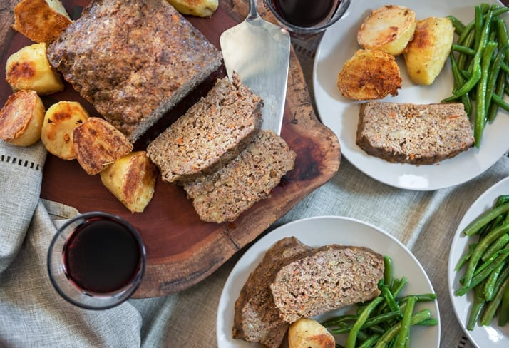 overhead food image of italian meatloaf served with green beans and roasted potatoes