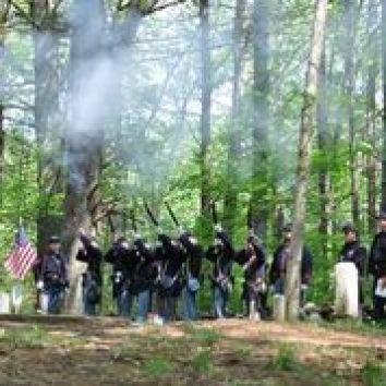 SUVCW Members firing rifles