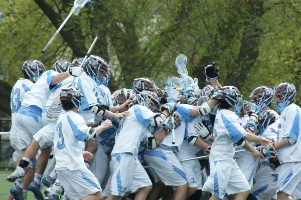 Tufts' men's lacrosse team celebrated its fifth-straight NESCAC crown this afternoon with a 20-13 win over Amherst College. (Photo Credit: Matt Noonan for NoontimeSports.com)