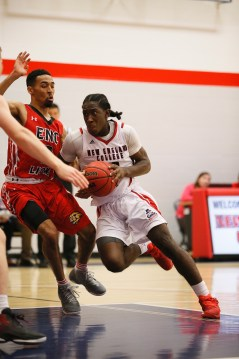 Izaiah Winston-Brooks has helped New England College men's basketball enjoyed an impressive start to their 2016-17 campaign. (PHOTO CREDIT: New England College Athletics)