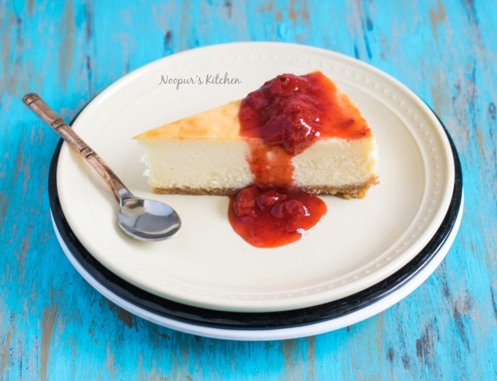 NY style cheesecake with strawberry sauce