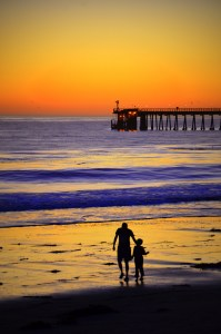 A father and son share a special sunset.