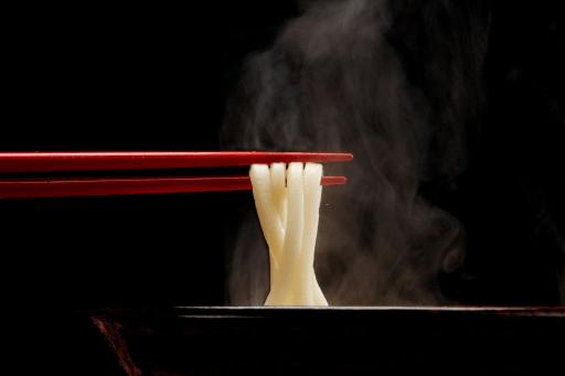Eat Noodles with Chopstick