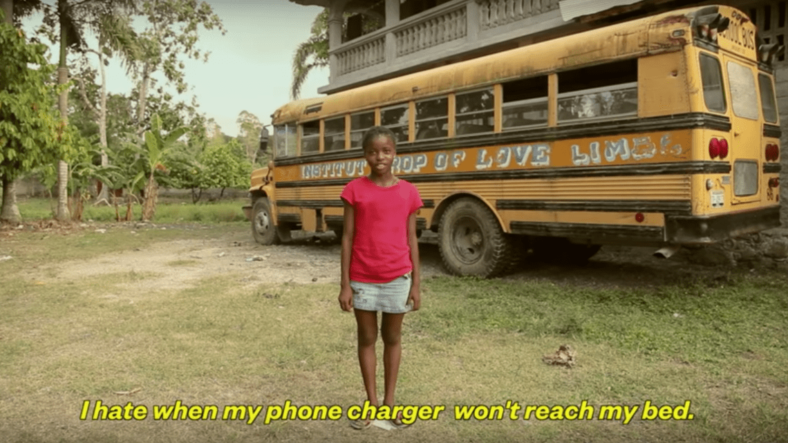 A still from the WaterIsLife viral video starring people in Kenya reading first world problems.