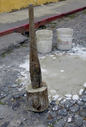 cobblestone street repair with a city supplied tool - Antigua