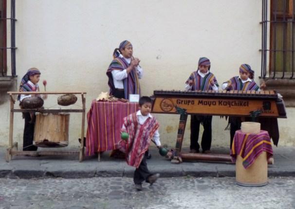 Street performers and a marimba band - Antigua,Guatemala