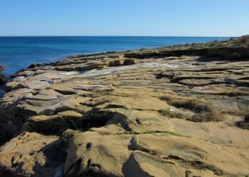 sea smoothed cliffs, Praia da Luz, Portugal