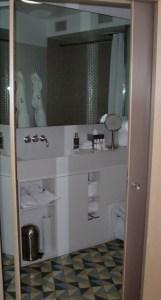 Smallish bathroom through the door.