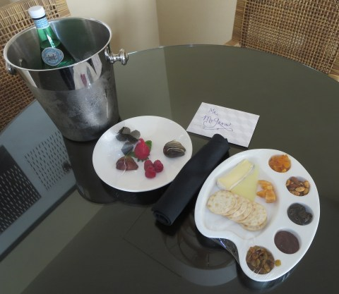 Sparkling water, fruit, cheese and a nice note.