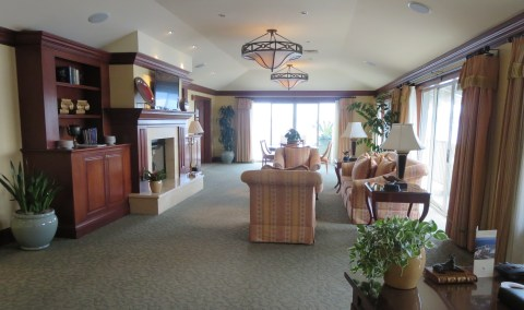 The Living Room space of the Presidential Suite surrounded by balconies with a view of the Bay