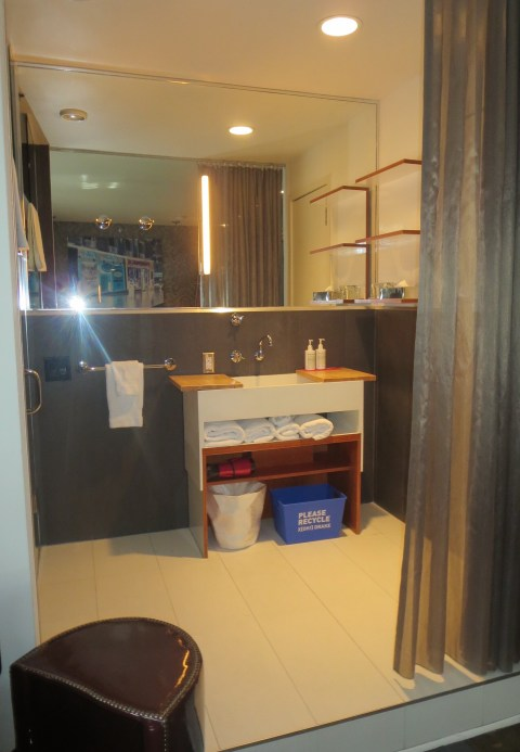 Bathroom space set off by a thin curtain