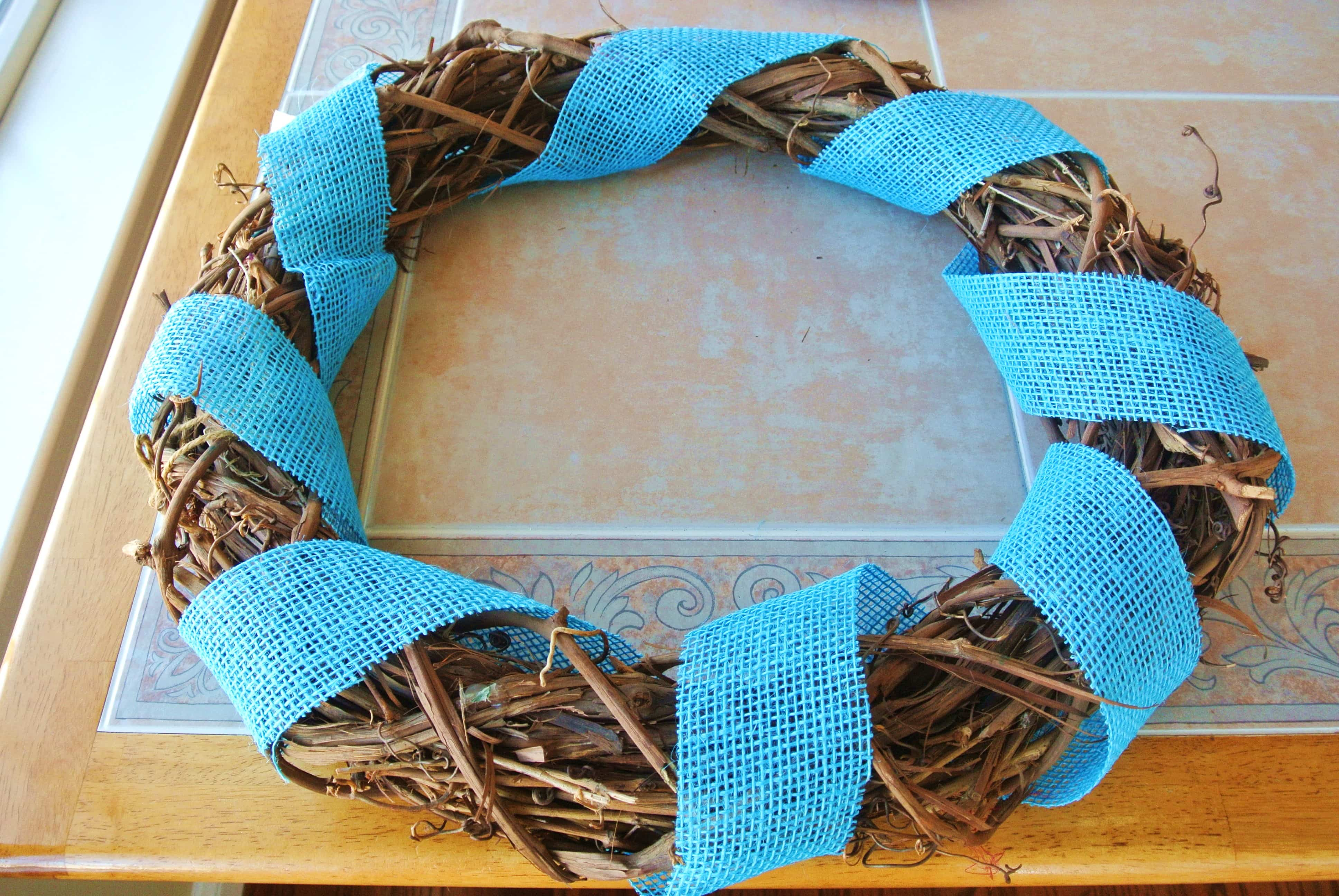 Blue burlap ribbon around wreath