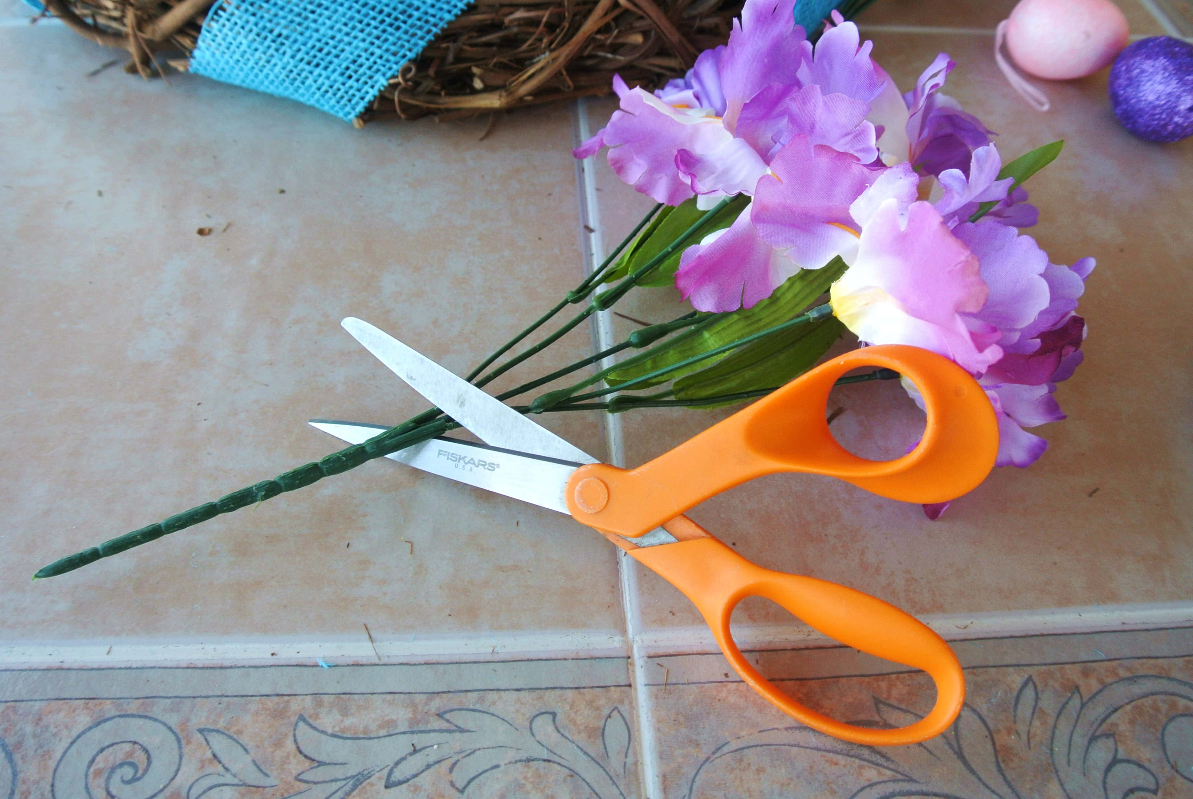 Cut faux purple flowers, leaving 3-4 on the ends to tie.