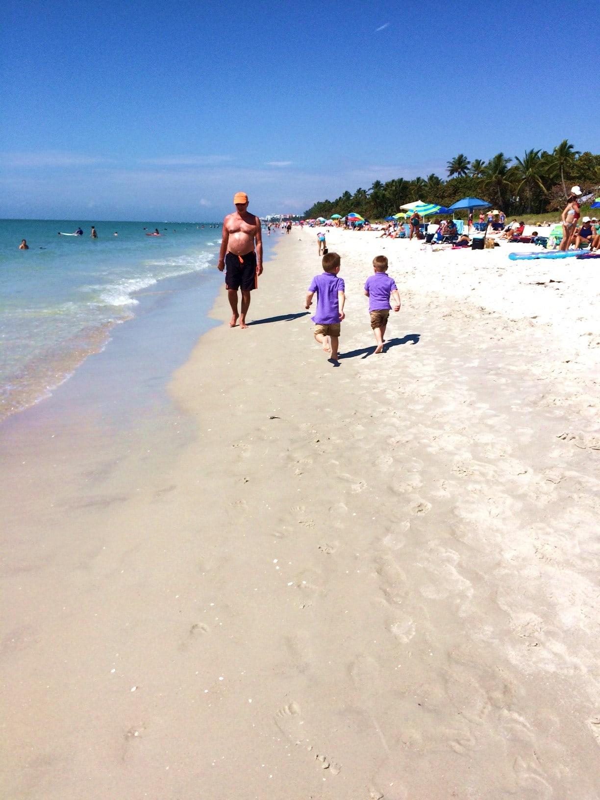 Boys running on Naples Beach