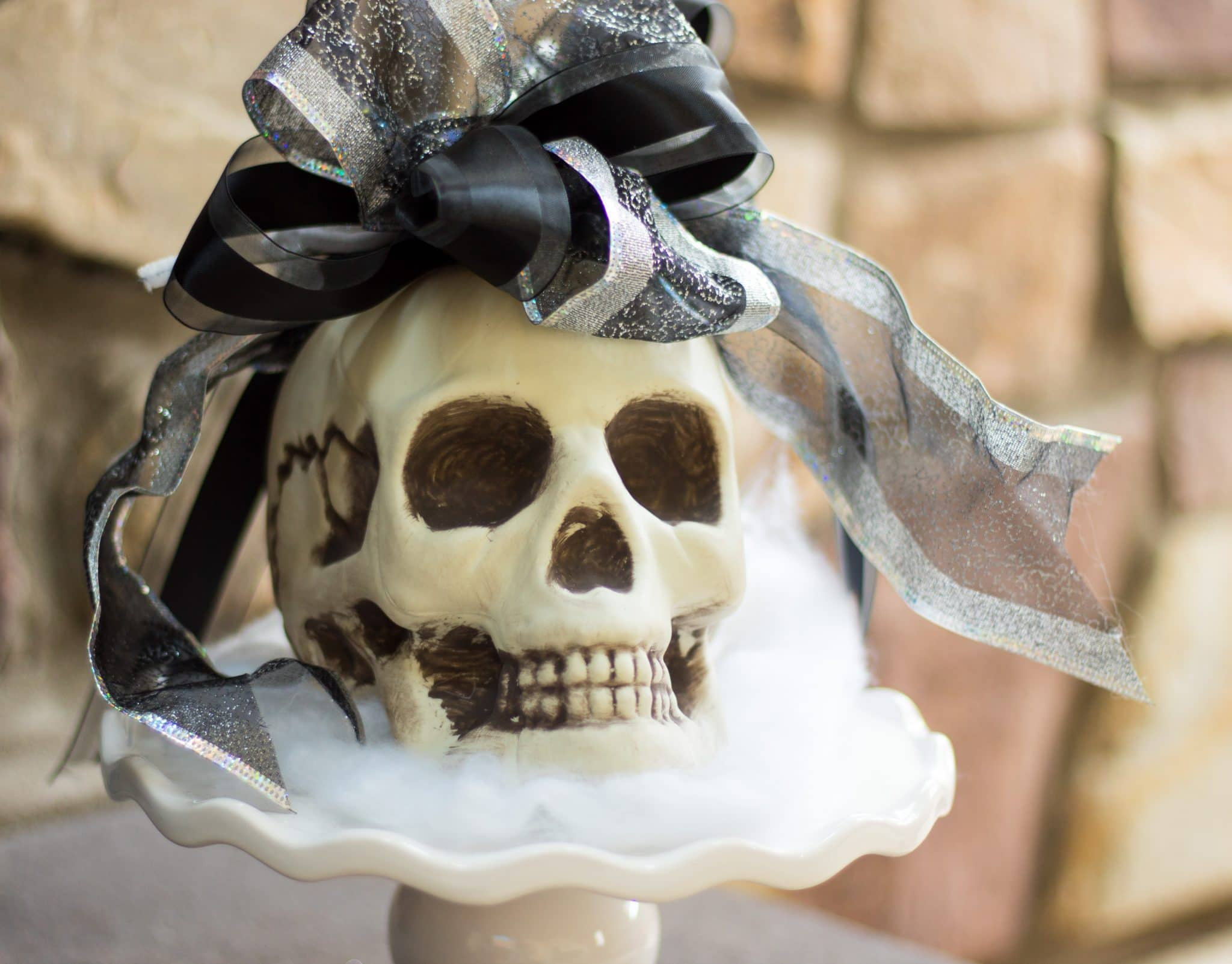 Skull on a Mini Cake Plate- Cheap and Easy Halloween Decorating Ideas & Cheap and Easy Halloween Decorating Ideas - No Plate Like Home