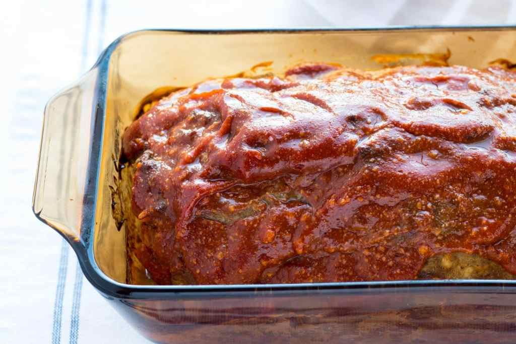 Spicy BBQ Meatloaf with Smoky Sweet BBQ Sauce Topping is a deliciously seasoned, flavorful moist BBQ meatloaf your family will want seconds. Freezes well!