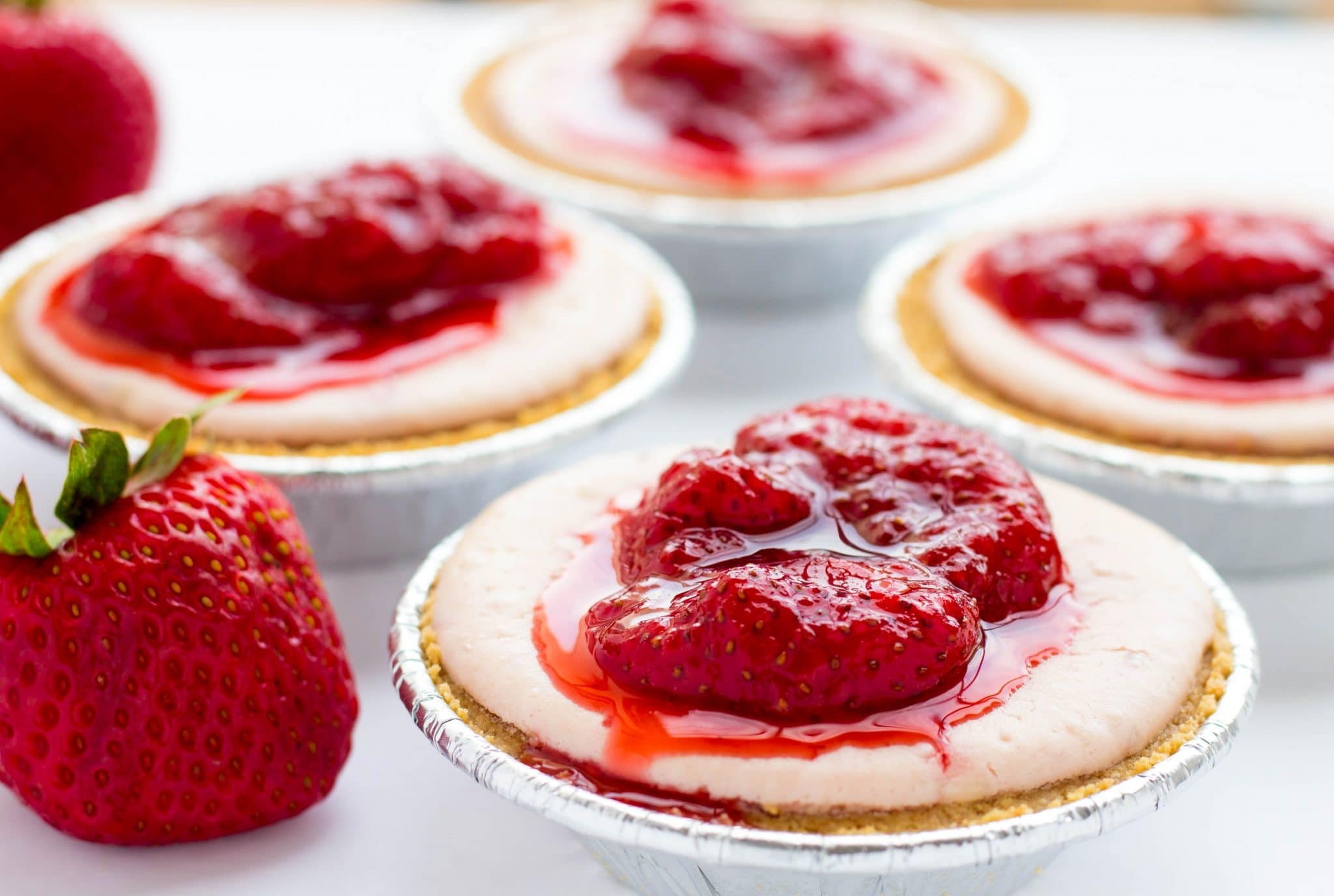 The Best Mini Strawberry Cheesecakes with Strawberry Sauce
