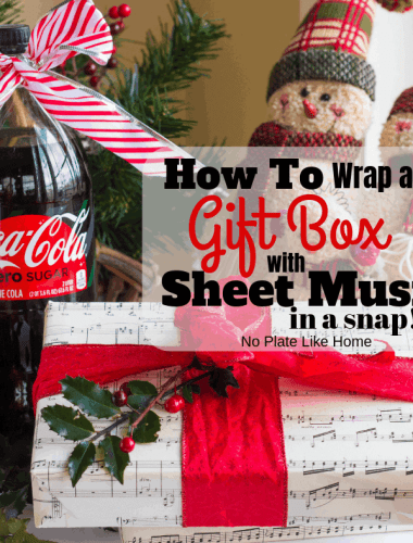 This DIY tutorial on How to Wrap a Gift Box with Sheet Music in a Snap is a creative way wrap a gift. Cranberry Vanilla Coke-tail recipe included.