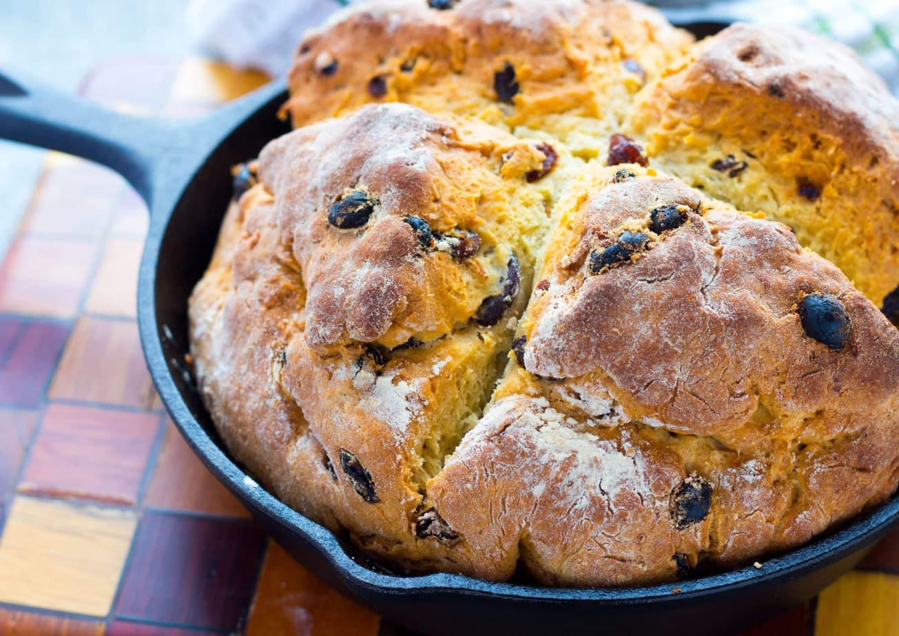 Homemade Skillet Irish Soda Bread with Raisins is the delicious American version of a traditional Irish Soda Bread. It's crusty with a touch of sweetness!