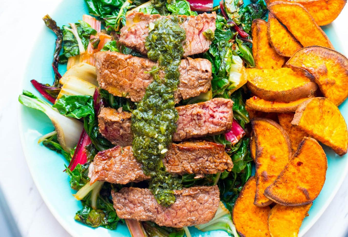 Sun Basket Steaks with chimichurri and harissa-roasted sweet potatoes