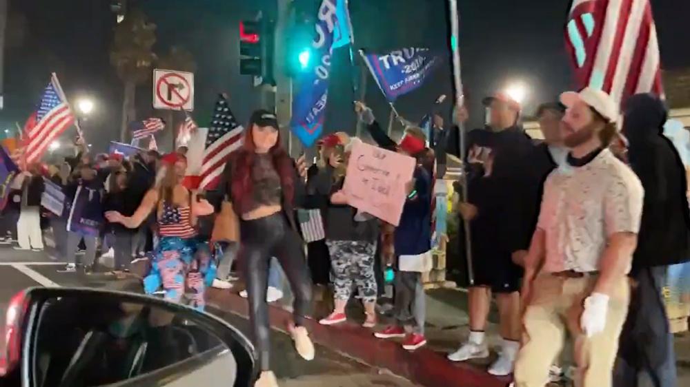 On first night of California curfew, Huntington Beach patriots hit the streets