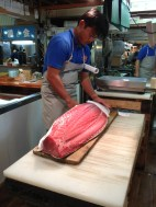 Wrapping a big slab of tuna, perhaps from this morning's action.