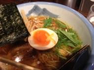 Soft boiled egg, mizuna, bamboo shoots and nori in the yuzu ramen (Afuri)