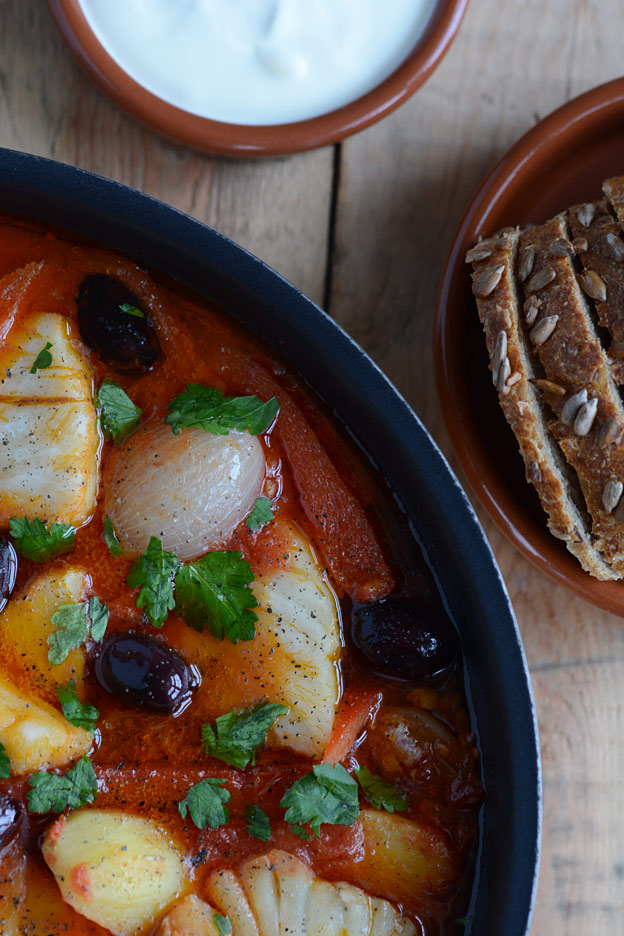 Salt cod stew, bacalao, with sour cream and crusty bread.