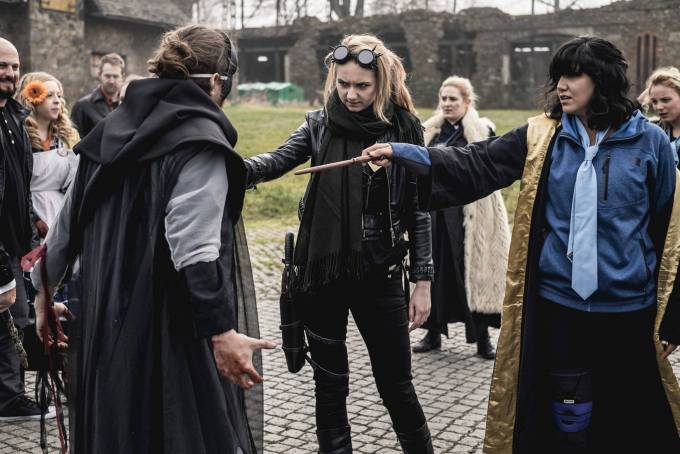 wizards point their wands at each other