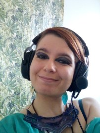 In-game photo of Cosma Lodoni with headphones on.