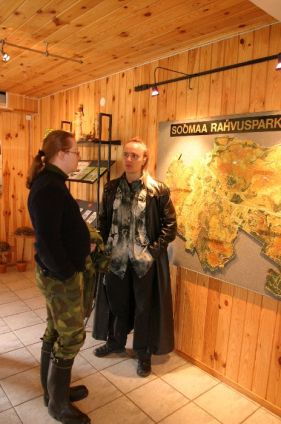 Two people with long hair next to a map of Sooma