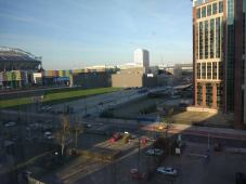 The view from the room on the 6th floor - Amsterdam Arena on the left with the Arena Boulevard in front, AFAS Live in the middle and some tall building on the right.
