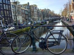 Typical Amsterdam view - cannal plus bicycle