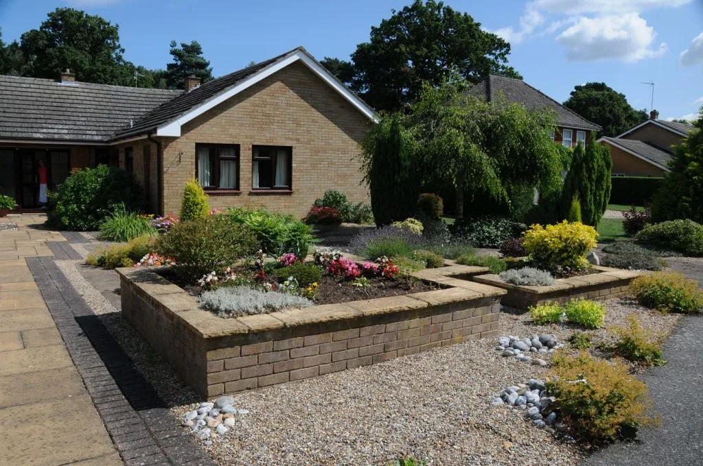 Raised brick planters in a large front garden