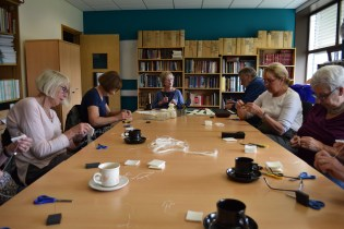 Volunteers at The Archive Centre sewing seal socks