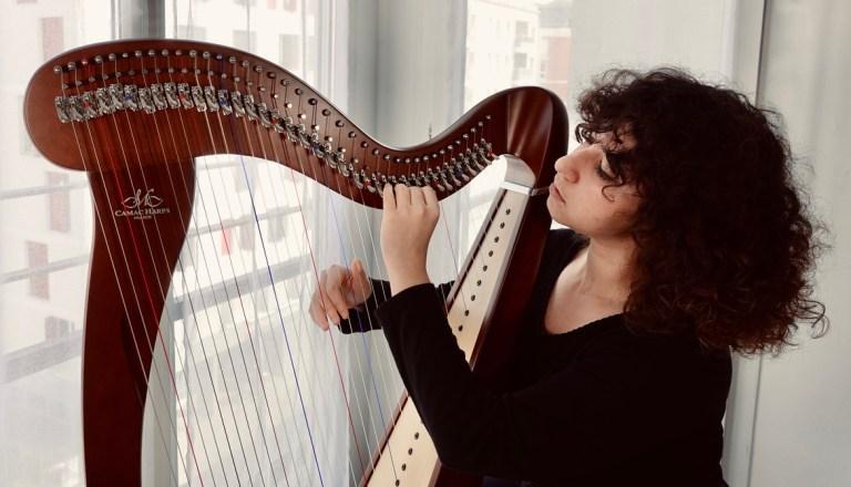 norma fall playing harp