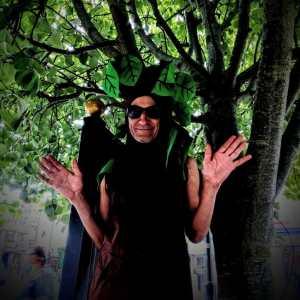 Man dressed as a tree in Glastonbury