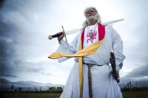 Bearded man in druid robes with sword