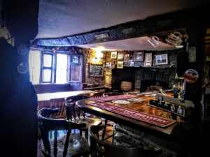 Rifleman's Arms, Glastonbury. Bar in oldest part of the building. Roof beams, low ceiling, stone windows. Photo by Vicki Steward.