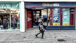 Knight in Armour in Glastonbury High St by Vicki Steward