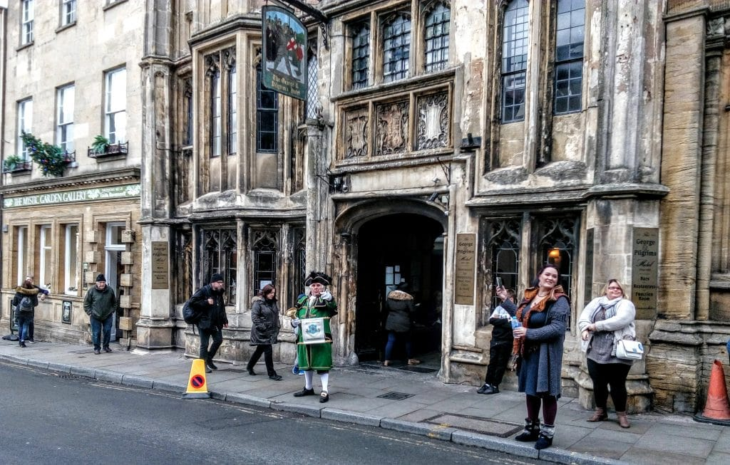Glastonbury High St with a town crier in traditional robes