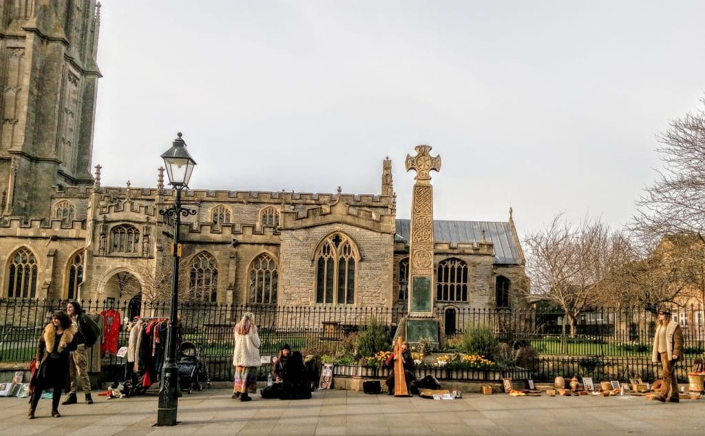 Harpist and Street Traders in front of St John's Church. Glastonbury 2017