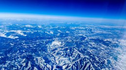 Snow covered mountains, looking south from airplane window