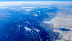 Mountain ridge east of a large, flat brown valley near Duckwater, Nevada (looking south from airplane window)