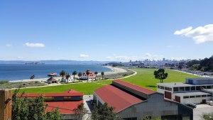View of San Francisco skyline, Crissy Field and San Francisco Bay at bike path entrance to Gold Gate Bridge