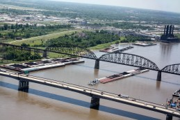 A barge crossing under bridges on the Mississippi River