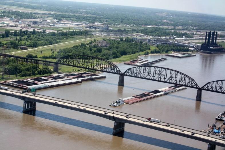 A barge crossing under bridges on the Mississippi River