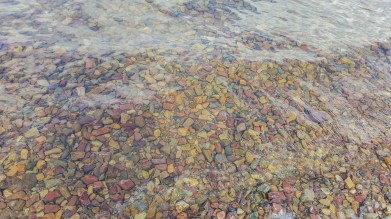Multi color rocks on the bottom of Bowman Lake